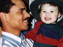 MDAH founder Mark Abraham and son Eric in 1997